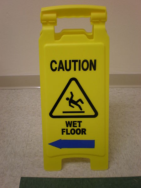450px-Yellow wet floor caution sign in English